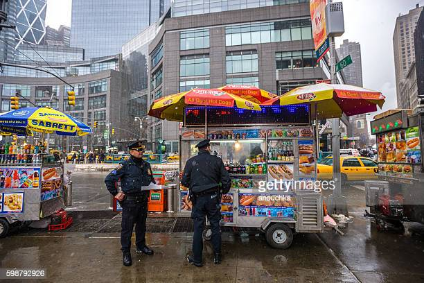 Policemen buying snacks from fast food truck, NYC, USA