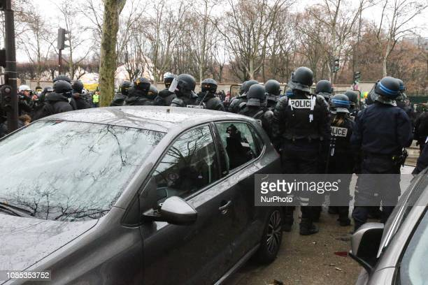 Policemen charge Gilets Jaunes demonstrators in front of the Hotel national voice over Invalides in Paris on January 19 2019 during a demonstration...