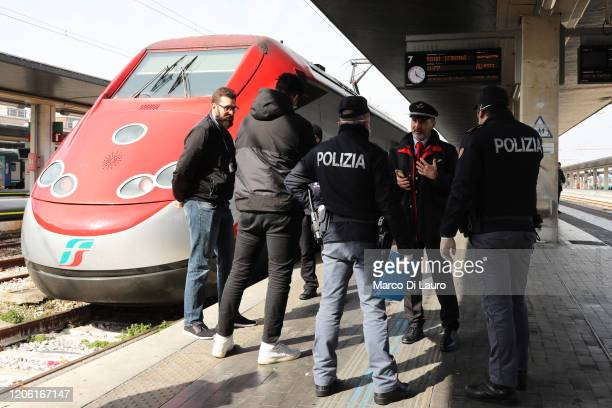 Policemen check citizens and tourists at the Venice Santa Lucia railway station, to make sure that they are not violating the quarantine, before they...