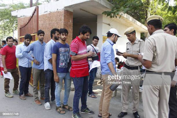 Policemen check UPSC aspirants before the Civil service Preliminary exams outside an examination center at Government Girls College MG road on June 3...