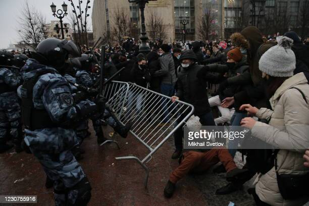 Policemen clash with participants of the unauthorized protest rally against the jailing of opposition leader Alexei Navalny on January 23, 2021 in...