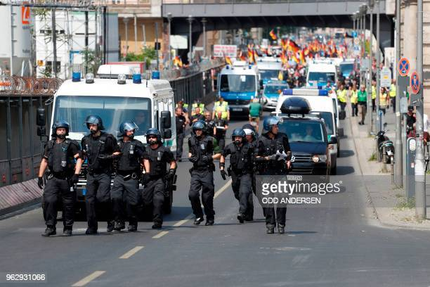 Policemen clear the road as Alternative for Germany 's demonstrators march on a bridge over the Spree during the demonstration for the future of...