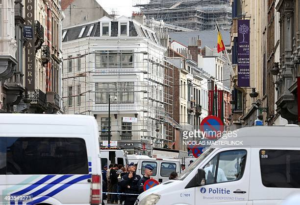 Policemen close the access of the scene of a shooting near the Jewish Museum in Brussels on May 24 2014 Three people were killed and one badly...