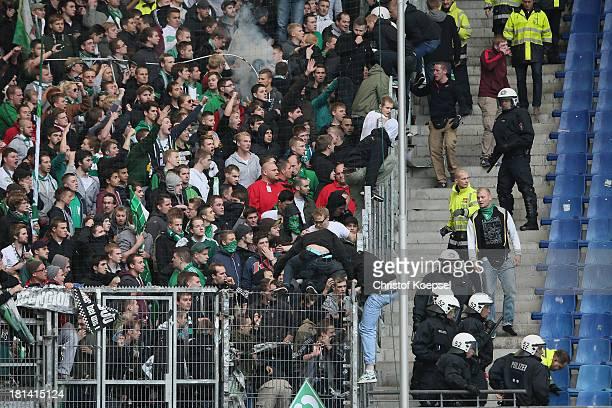 Policemen consents hooligans of Bremn prior to the Bundesliga match between Hamburger SV and Werder Bremen at Imtech Arena on September 21 2013 in...