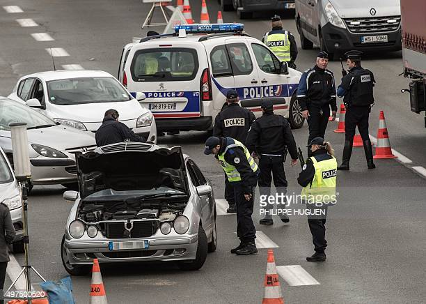 Policemen control a car as part of security measures set following terrorist attacks in Paris on November 17 2015 at the FrenchBelgium border in...