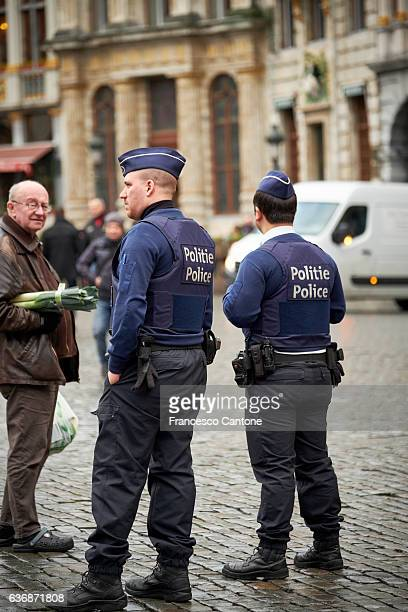 Policemen control a public place in the Belgian capital city