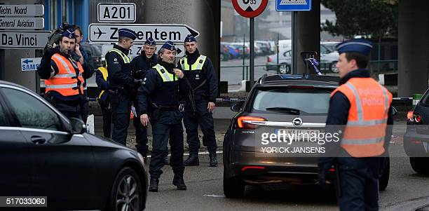 Policemen control motorists near Brussels airport in Zaventem on March 23 one day after two massive suicide blasts by men with bombs in their bags...