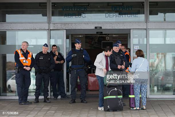 Policemen control passengers at the entrance of Bruges' airport in Ostende on March 23 one day after two massive suicide blasts by men with bombs in...
