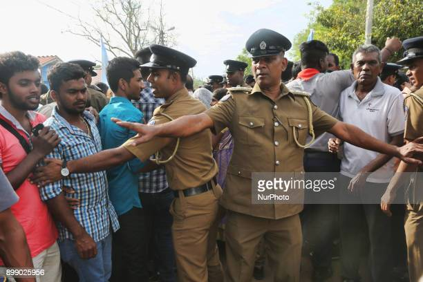 Policemen control the huge crowd of Catholic pilgrims at the Shrine of Our Lady of Madhu during the Feast of Our Lady of Madhu in Mannar Sri Lanka...