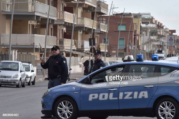 Policemen control vehicles on November 28 2017 during searches in Ostia Rome's seaside district where the Spada clan lives Extraordinary checks and...