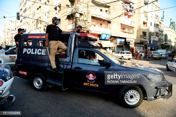 Policemen disperse stall holders as time end during a government-imposed nationwide lockdown as a preventive measure against the COVID-19 coronavirus...
