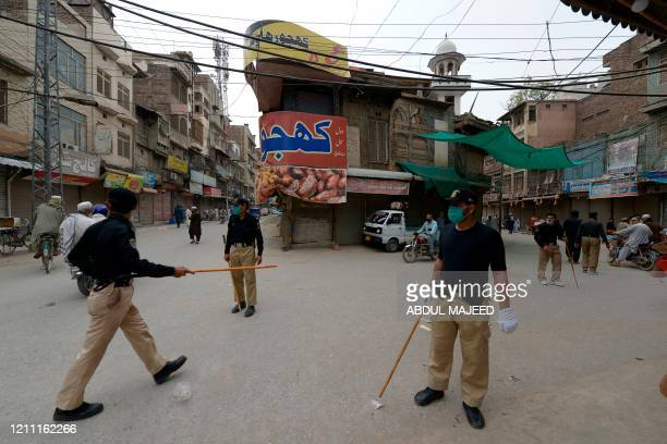 Policemen disperse vendors as time to close a market arrived during a governmentimposed nationwide lockdown as a preventive measure against the...