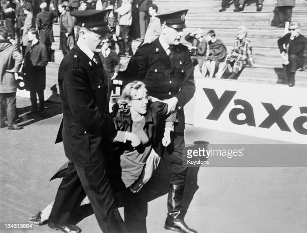 Policemen drag away a protestor during an antiapartheid demonstration in Oslo Norway 16th May 1964 The sitdown protest took place on the Madserud...
