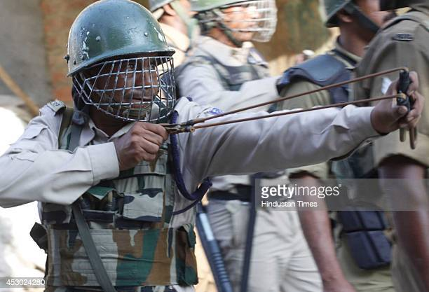 Policemen during a protest called by Syed Ali Shah Geelani separatist leader following separatists' call for postprayers protests against the Kaunsar...