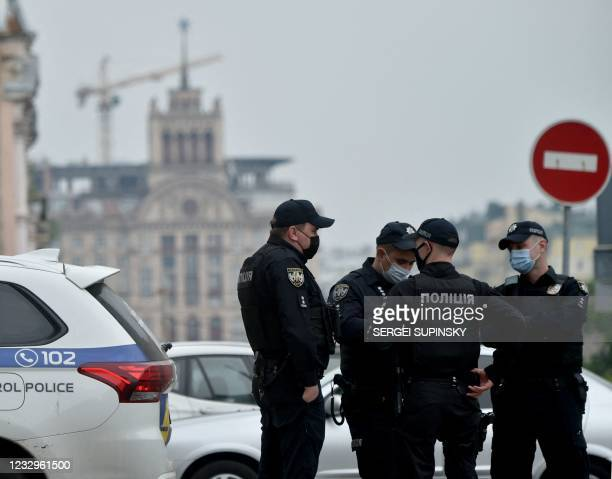 Policemen gather outside a residential building housing the apartment of Vitali Klitschko, Kiev mayor and former boxing heavyweight World champion,...