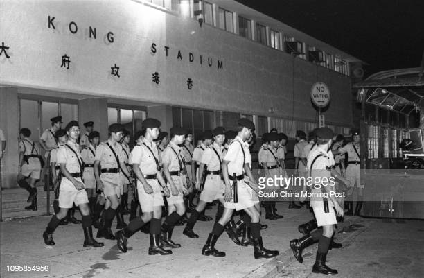 Policemen get ready to control rioters soccer fans who are angry with Hong Kong's 01 defeat by South Korea in the World Cup's qualifying match...