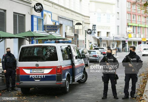 Policemen guard the area on November 3, 2020 close to a crime scene in Vienna after a shooting. - A huge manhunt was under way Tuesday, November 3,...