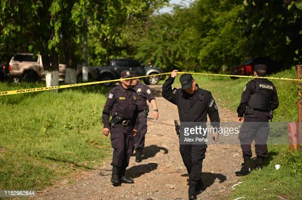 Policemen guard the exit of vehicles that move the bodies of Óscar Alberto Martínez Ramírez and his daughter Valeria to San Romero memorial park of...