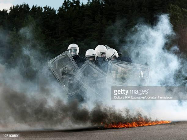 Policemen in a riot