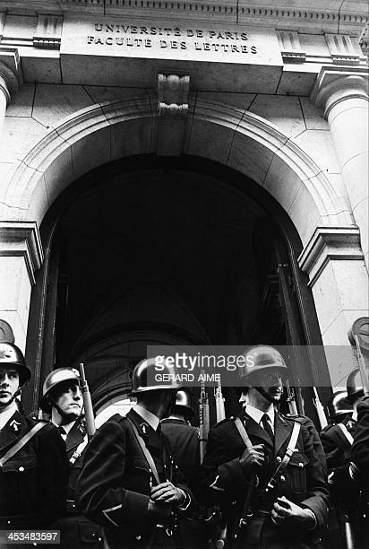 Policemen in front of the Sorbonne University during a demonstration in Paris, France on May 3, 1968.