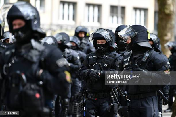 Policemen in riot gear are seen during the protest against the rightwing populist Alternative for Germany political party federal congress on April...