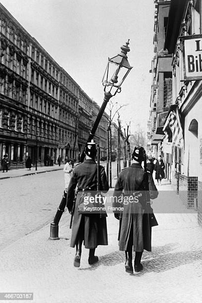 Policemen in the street after demonstration during 1st May parade on May 1, 1929 in Berlin, Germany.