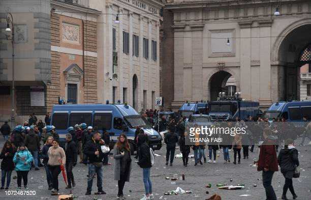 Policemen in vans and antiriot trucks stand guard on Piazza del Popolo square after supporters of Eintracht Frankfurt litered the place with empty...