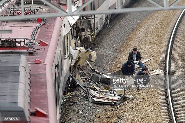 policemen intervene after a train exploded at the Atocha train station in Madrid 11 March 2004 At least 173 people were killed and some 600 injured...