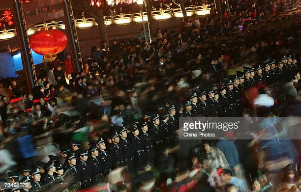 Policemen keep order as tourists flock to visit the Confucius Temple during Lantern Festival celebrations on March 4 2007 in Nanjing of Jiangsu...