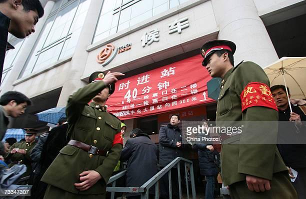 Policemen keep order at the Nanjing Coach Station during Chunyun travel peak on February 16 2007 in Nanjing of Jiangsu Province China Chunyun or the...