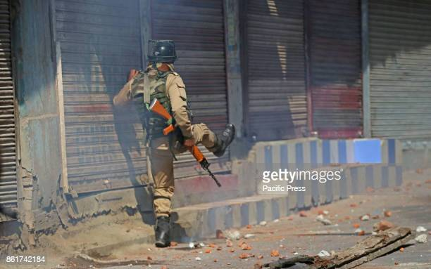 A policemen kicks shear gas shell towards protesters in habba kadal soon after mysterious braid chopping incident in the area more then 100 braid...