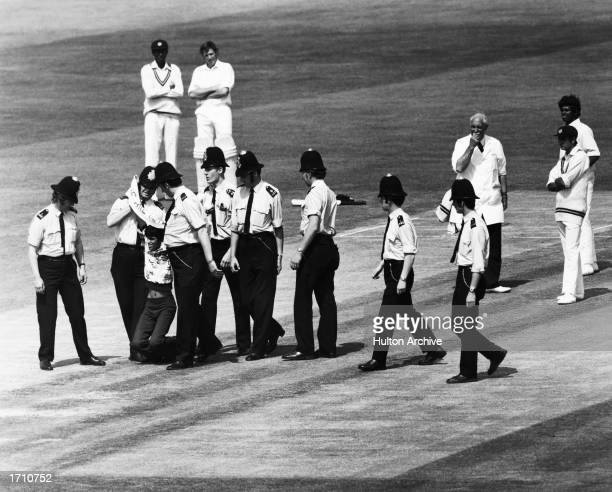 Policemen lead a demonstrator off the pitch during the Prudential World Cup match between Australia and Sri Lanka at the Kennington Oval London Great...