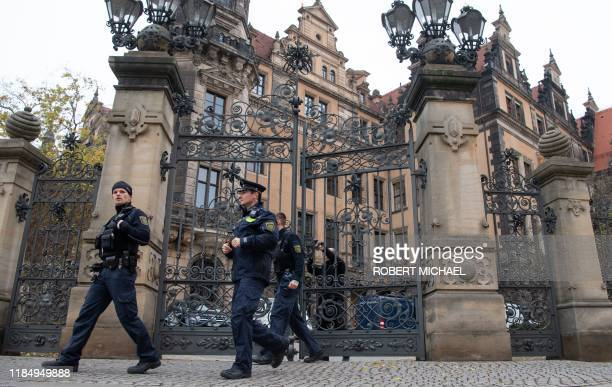 Policemen leave the Residenzschloss Royal Palace that houses the historic Green Vault in Dresden eastern Germany on November 27 2019 The Green Vault...