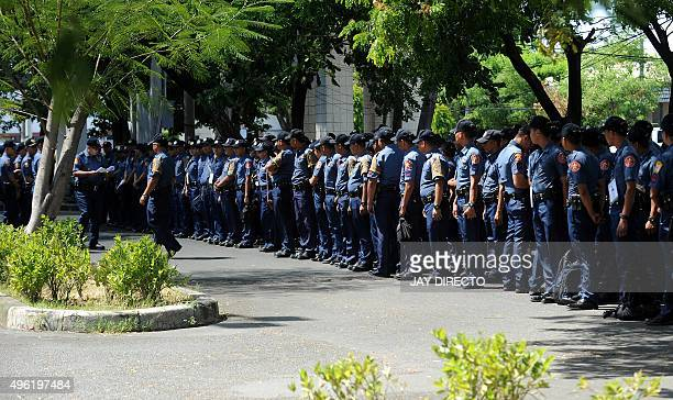 Policemen line up to secure the Asia Pacific Economic Cooperation summit to be held in the Philippines later this month, in Manila on November 8,...