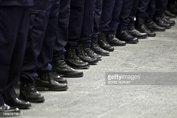 Policemen listen to a speech of the BouchesduRhône prefect after their arrival in Marseille southern France on November 9 2012 French Prime Minister...