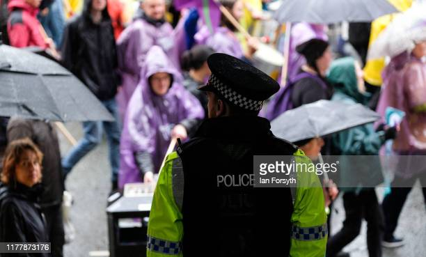 A policemen looks on as protesters take part in a large scale demonstration against austerity and the Conservative government on September 29 2019 in...