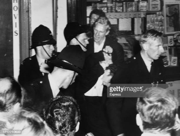 Policemen making an arrest during the Notting Hill Race Riots London UK 1st September 1958