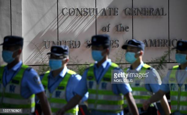 Policemen march in front of the US consulate in Chengdu, southwestern China's Sichuan province, on July 26, 2020. - The Chengdu mission was ordered...