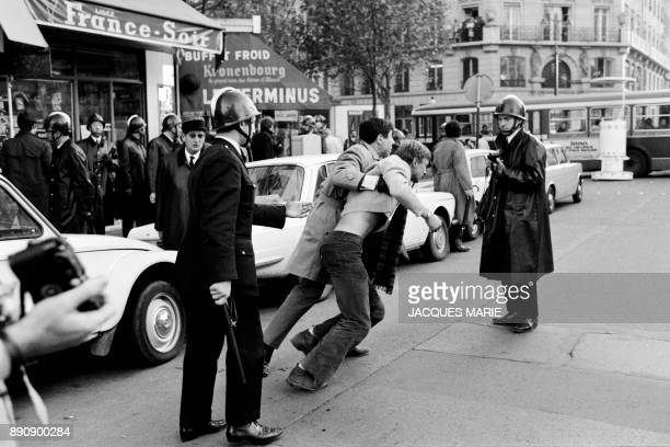 Policemen, member of the CRS, arrest demonstrators in Rivoli street, during a demonstration on May 6, 1968. The demonstrations, which were banned,...
