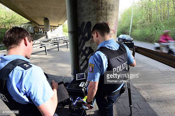 Policemen monitor cars during a nationwide police action to catch people for speeding on April 16 2015 in Frankfurt am Main Germany The police want...