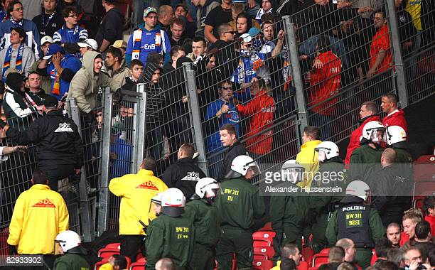 Policemen observe fans of KSC screaming angry during the Bundesliga match between VfB Stuttgart and Karlsruher SC at the Mercedes Benz Stadium on...