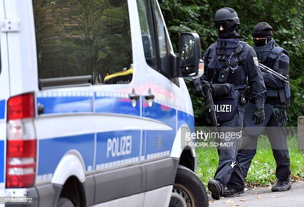 Policemen of a special unit are pictured at the Yorckgebiet district of Chemnitz eastern Germany where German police commandos hunting a fugitive...