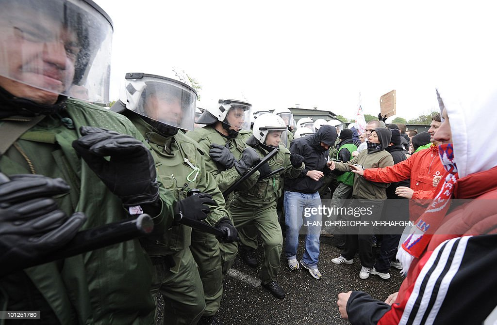 Policemen of Germany's Bereitschaftspolizei (Republican security company, take part in an exercise with French anti-riot policemen as part of a training of maintaining order during a rally, on May 6, 2010 in Rosieres-en-Haye, eastern France.