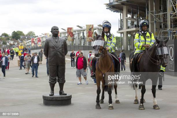 Policemen on horses by the Herbert Chapman statue outside the Emirates Stadium