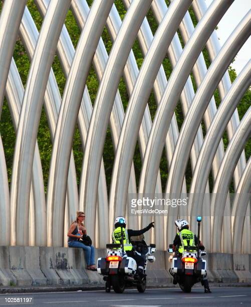 Policemen on motorbikes talk to a woman at Los Arcos de la Vaguada and the Avenida de la Ilustracion in the city of Madrid on May 24 2010 in Madrid...