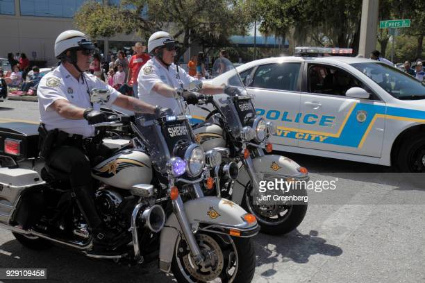 Policemen on motorcycles on the Grand Parade at the Florida Strawberry Festival