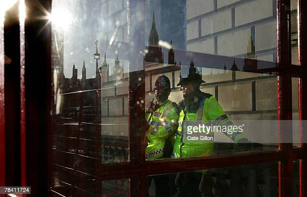 Policemen on patrol around the Whitehall area on December 12, 2007 in London, England. Debate continues over a pay agreement between police and the...