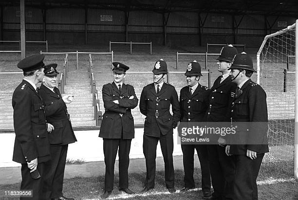 Policemen on the pitch at West Ham Football Club at Upton Park Newham East London circa 1970