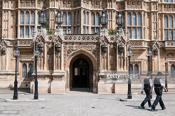 Policemen Passing Houses of Parliament in London