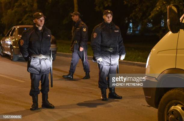 Policemen patrol a street near a college in Kerch Crimea on October 17 after a student opened fire in a technical college in the Russianannexed...
